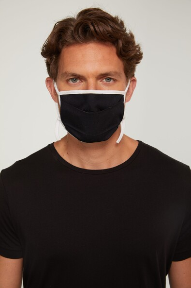Pleated mask with drawsting adjustement