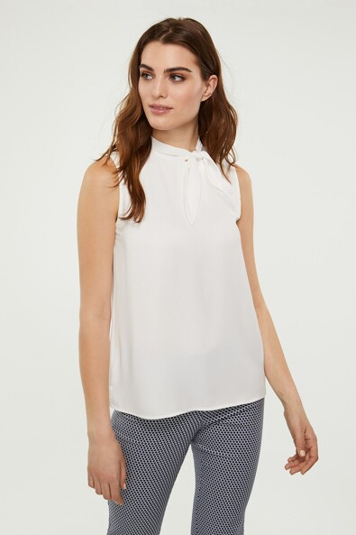 Sleeveless top with tied collar
