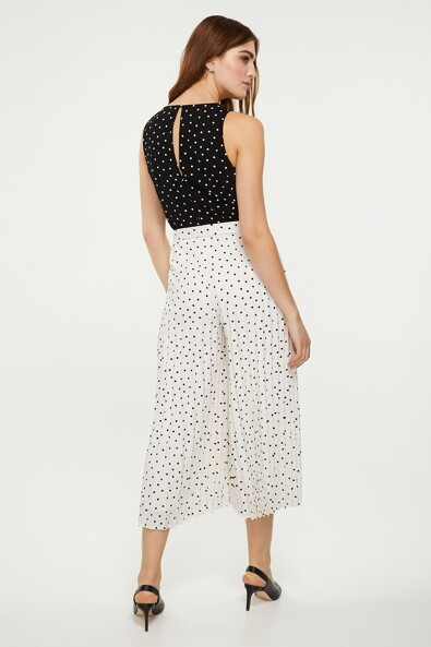 Polka dot jumpsuit with pleated bottom